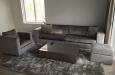 Hoogglans salontafel, moderne bank en luxe fauteuil op maat