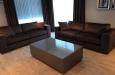 Luxe bankstellen en hoogglans salontafel op maat