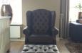 Design fauteuil met knopen in skai stof