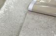Hocker op maat in velours Biscayne stof