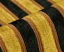 tratino-5033-54-zwart-goud-geel-strepen-meubelstoffen-chenille-contract